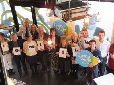 Greater Manchester Living Wage celebration of 100 employers photo for GMPA article