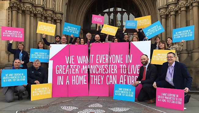 GMHP pledges banner for GM Poverty Action article